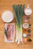Ingredients for a sour cream flan with leeks and bacon