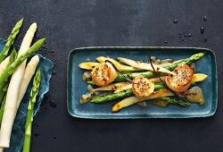 Scallops with warm white and green asparagus, passion fruit and vanilla