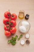 Ingredients for caprese salad with basil pesto