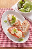 Oven-baked chicken breast with tomatoes and mozzarella