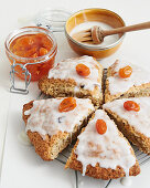 Scones with icing and candied kumquats