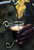 Touba (coffee specialty, Senegal) being poured into a glass