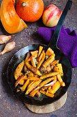 Finger-shaped pumpkin dumplings with apple