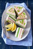 Several pieces of fresh cheese terrine with salmon and peas