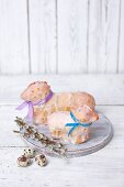 Two baked Easter lambs with a sugar glaze and colourful ribbons