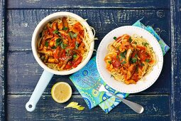 Spaghetti with tomato sauce, celery and sprats