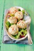 Poultry salad balls on a mixed leaf salad