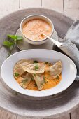 Celery-filled ravioli with red pepper sauce