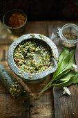 Homemade wild garlic pesto in a mortar