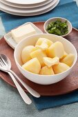 Peeled and boiled potatoes with butter