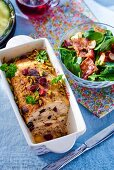 Chicken terrine with cherries and pistachios, served with spinach and bacon salad