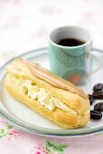 An eclair with coffee-flavoured icing