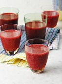 Raspberry and spinach smoothies in glasses