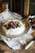 Gooseberry pavlova cake with whipped cream