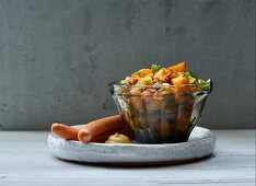 Spicy potato salad with bock sausages