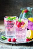 Raspberry lemonade with lemon slices and mint