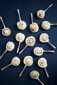 Puff pastry cinnamon snails on sticks