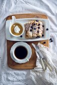 Vegan waffles with apple sauce, blueberries and a cup of coffee