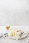 Homemade ricotta with herbs and olive oil