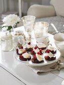 Chocolate peanut cakes with raspberries and vanilla ice cream