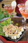 Tortillas with fresh cheese, Parma ham, and Temptation cocktails