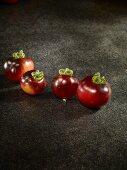 Four blue bayou tomatoes