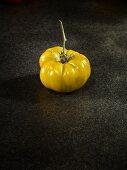 A green Malakhitovaya Shkatulka tomato