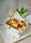 Garlic frittata with potatoes, peppers and sausages
