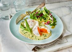 Poached eggs on bear's garlic sauce with a side salad