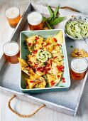 Baked nachos with wild garlic mayonnaise, served with beer