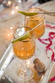Homemade pear vodka in crystal glasses for Christmas