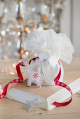 A gift-wrapped Christmas pudding