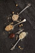 Vintage spoons with oats, chopped hazelnuts, ground almonds and nutella chocolate spread