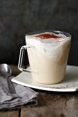 A white coffee and almond smoothie with coconut