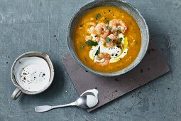 Carrot and lentil soup with prawns