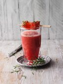 A watermelon drink with rosemary