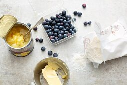 Blueberries, butter, baking mixture and tinned pineapple for quick and easy dump cake