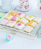 Homemade mini cakes decorated with sugar flowers