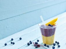 A mango and blueberry smoothie with yoghurt