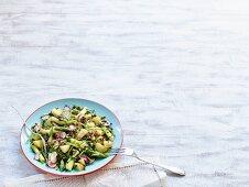 Potato salad with green asparagus, radishes and beluga lentils