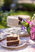 Summery chocolate sponge cake on a table outdoors