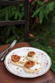 Blinis (Russian pancakes made from buckwheat flour) served with sour cream, walnuts and fried wild mushrooms