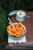Oven-baked sweet potato fries served with vegan cashew and garlic sauce