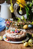 Easter cake with chocolate, meringue and colourful Easter eggs