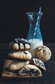 Homemade stuffed chocolate chip cookies and a bottle of milk