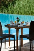 Set breakfast table next to swimming pool