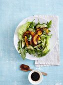 A salad with cucumber, rocket, and grilled peaches - 'Peach Tree'
