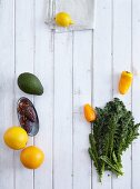 Oranges, dates, avocado, lemon, peppers and curly kale