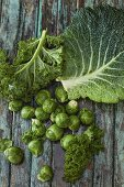 Various types of cabbage on a wooden background