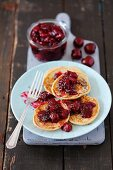 Pancakes with cherry jam and chia seeds